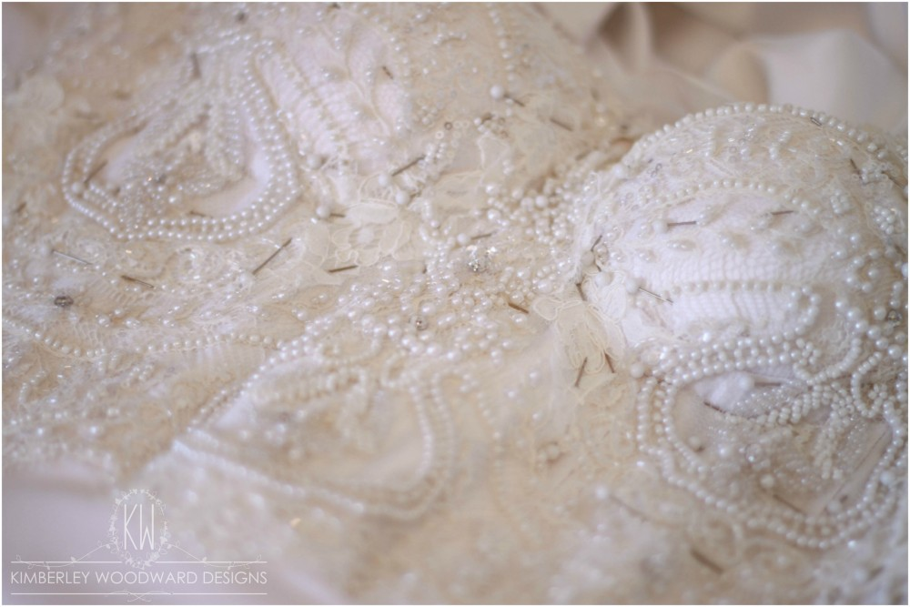 Hand appliquéing the stunning French lace.